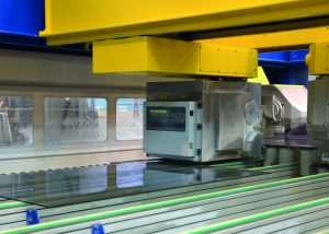 Machine cutting glass demonstrates how Industry 4.0 affects glass manufacturers